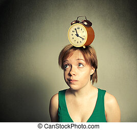 girl with the alarm clock on head