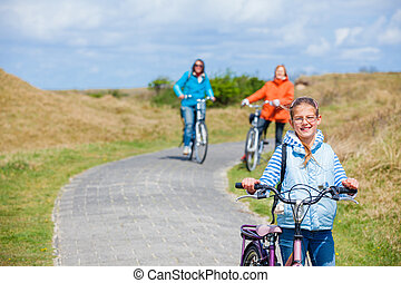 Girl with the bike - Cute girl with the bike with her mother...