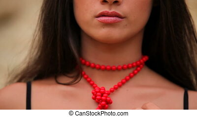 Girl with the red necklace