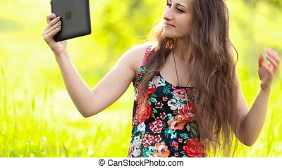girl with the tablet makes selfie