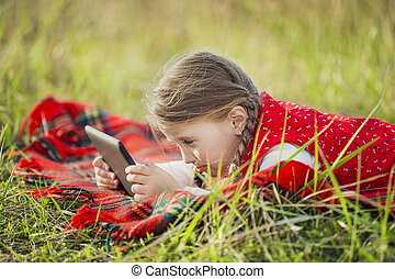 Girl with the tablet