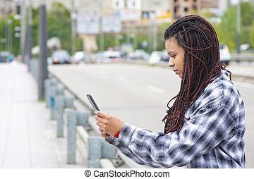 girl with the tablet on the street