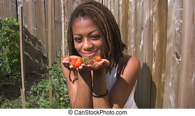 Girl with tomatoes.
