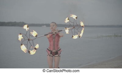 Girl with torch fire show. slow motion - Girl with a torch...