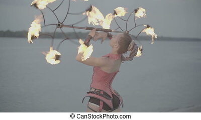 Girl with torch fire show. slow motion S-Log3 - Girl with a...