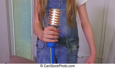 Girl with toy microphone