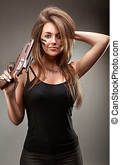 Girl with two old gun in the hands