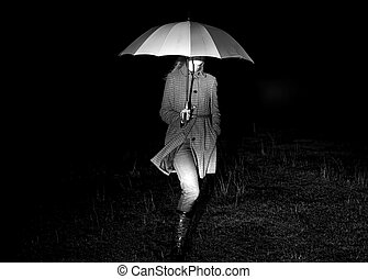 Girl with umbrella at night in lights.