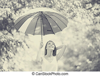 girl with umbrella at outdoor