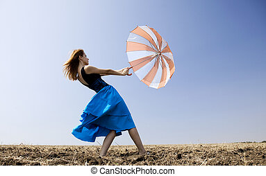 Girl with umbrella at outdoor.