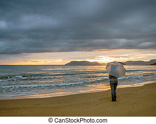 girl with umbrella in the sunset