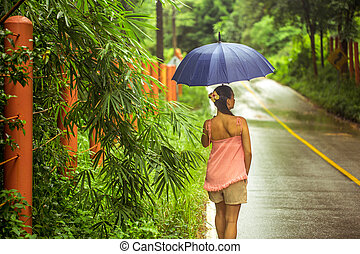 girl with umbrella on the road