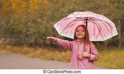Girl With Umbrella Under Rain