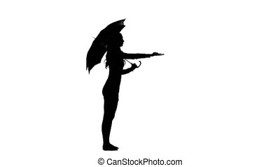 Girl with umbrella video silhouette - Girl is standing in a...