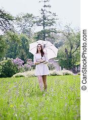 girl with umbrella walking