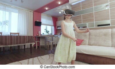 Girl with virtual reality helmet are funny dancing