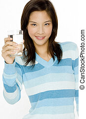 Girl With Water - A young asian woman with a glass of water