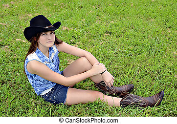 Girl with Western Style in Grass