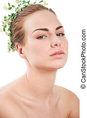 Girl with white and green flower wreath