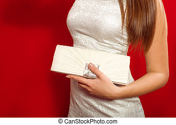girl with white clutch