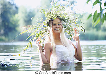 girl with wreath in a river