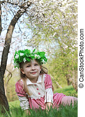 Girl with wreath under spring tree