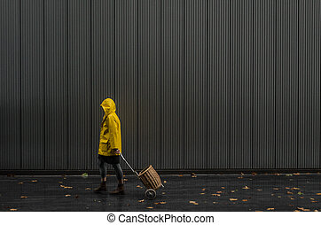 girl with yellow raincoat on a street