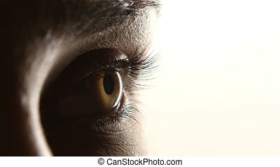 Girl without a make up with a clean face mograet and leads the eye up and down. Close up. Side view. White background