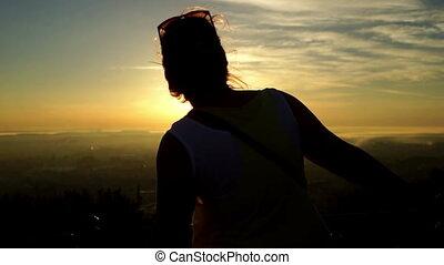 Girl woman dance sunset - Carefree women dancing in the...