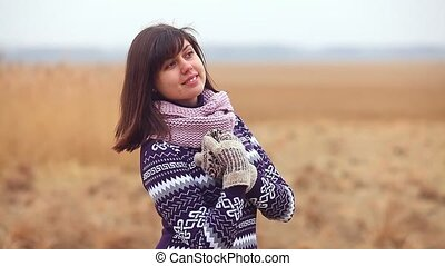girl woman portrait in sweater and mittens on the nature...