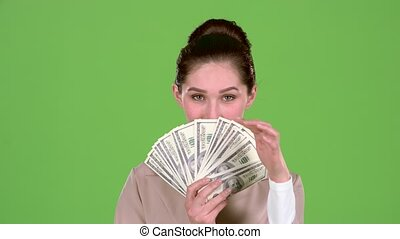 Girl won the jackpot in the lottery. Green screen. Slow...