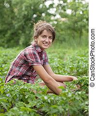 Girl working  in field