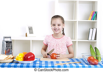 girl working in the kitchen cutting vegetables