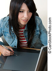 Girl working on a graphic tablet - A female working with a ...