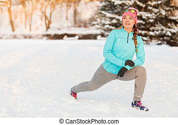 Girl working out in freezing temperatures, exercising in...