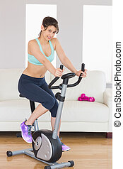 Girl working out on exercise bike