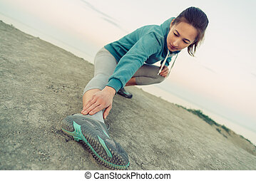 Girl workout on coast