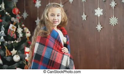 girl wrapped in a blanket