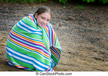 girl wrapped in a striped towel