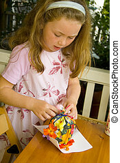 girl wrapping present