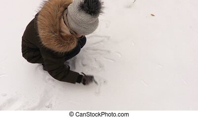Girl write on snow