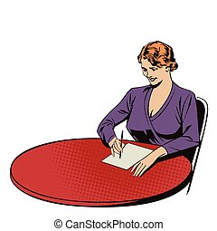 Girl writes, sitting at the table.