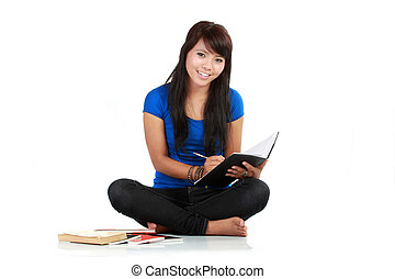 girl writing at note pad, white background
