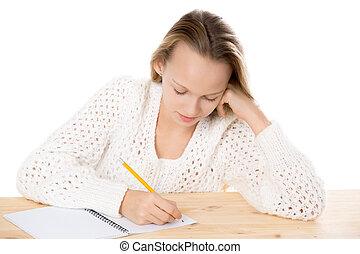 Girl writing in copybook