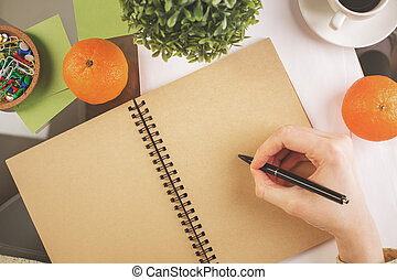Girl writing in notepad top