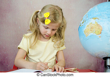 girl writing into notepad