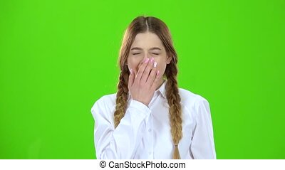 Girl yawns now . Green screen - Girl in a plaid skirt takes ...