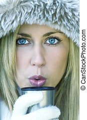 Girl Young Woman Drinking Coffe or Tea in Winter