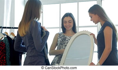 Girlfriend at the mirror looking at his new clothes