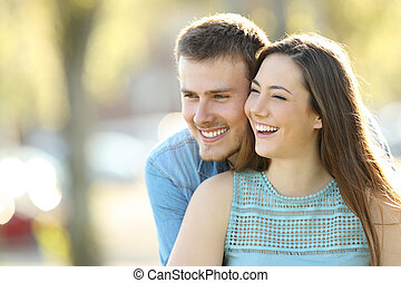 Girlfriend being hugged by her partner